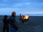 Federica and Lila with burning wings on Ocean Beach, San Francisco
